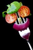 Fresh salad face. Salad face on a fork Stock Images