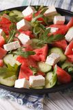 Fresh salad with feta, watermelon, cucumber and arugula close-up Stock Images