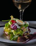 Fresh salad fitness. with arugula leaves of beet quail eggs and tomatoes cherry. stock photo