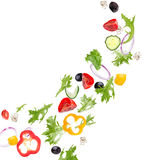 Fresh salad with flying vegetables ingredients Stock Image