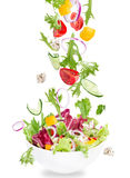 Fresh salad with flying vegetables ingredients Stock Photography