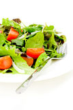 Fresh salad with fork. On white background Stock Photos
