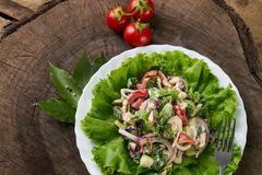 Fresh salad with fresh red cherry tomatoes royalty free stock photo
