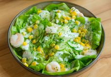 Fresh salad. With shrimps and corn kernels Stock Photo