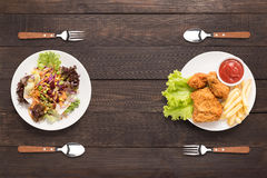Fresh salad and Fried chicken and french fries on the wooden bac Royalty Free Stock Image