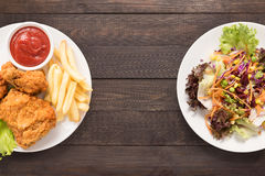Fresh salad and Fried chicken and french fries on the wooden bac Stock Photo