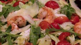 Fresh salad of fried shrimp and vegetables stock video