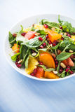 Fresh salad with fruits and greens Royalty Free Stock Image