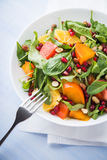 Fresh salad with fruits and greens Stock Image