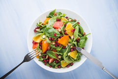 Fresh salad with fruits and greens Stock Images