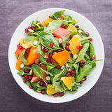 Fresh salad with fruits and greens Royalty Free Stock Images