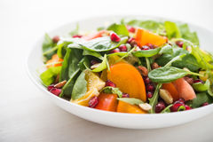 Fresh salad with fruits and greens Royalty Free Stock Photography