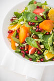 Fresh salad with fruits and greens Stock Photos