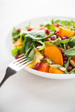 Fresh salad with fruits and greens on white background close up Royalty Free Stock Photography