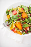Fresh salad with fruits and greens on white background close up Stock Photos