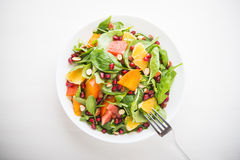 Fresh salad with fruits and greens Stock Photography