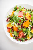 Fresh salad with fruits and greens Royalty Free Stock Photos