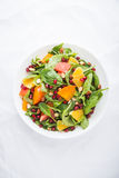 Fresh salad with fruits and greens on white background top view Royalty Free Stock Photos