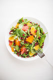 Fresh salad with fruits and greens on white background top view Royalty Free Stock Photography
