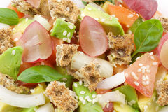 Fresh salad. With fruits and vegetablesn Stock Photography
