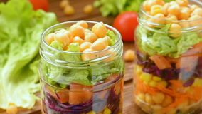 Fresh salad with garbanzo beans and vegetables stock footage