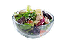 Fresh salad in glass bowl isolated on white background Royalty Free Stock Photography