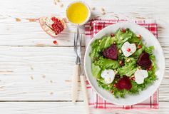 Fresh salad with goat cheese, roasted beets and lettuce. Royalty Free Stock Photos