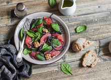 Fresh salad with grapefruit, spinach and red cabbage. On wooden background Stock Image