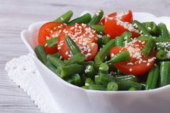 Fresh salad of green beans with sesame. Seeds and tomatoes Royalty Free Stock Images