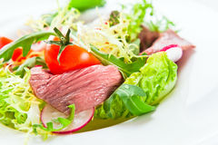 Fresh salad with greens and meat Royalty Free Stock Images