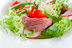 Fresh salad with greens and meat Stock Photos