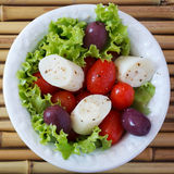 Fresh salad of heart of palm (palmito), cherry tomatos, olives Royalty Free Stock Photo