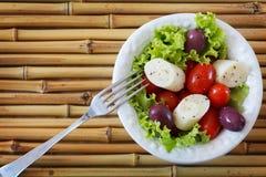 Fresh salad of heart of palm (palmito), cherry tomatos, olives Stock Photo