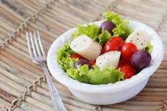 Fresh salad of heart of palm (palmito), cherry tomatos, olives Stock Photos
