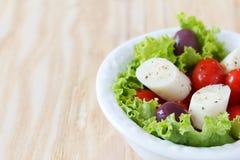 Fresh salad of heart of palm (palmito), cherry tomatos, olives Royalty Free Stock Image