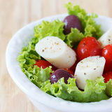 Fresh salad of heart of palm (palmito), cherry tomatos, olives Stock Photos