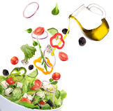 Fresh salad with ingredients in motion Stock Image
