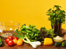 Fresh salad ingredients and yellow background Stock Photo