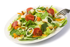 Fresh salad isolated on white Royalty Free Stock Images