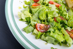 Fresh salad- lettuce with cherry tomatoes.  Stock Images