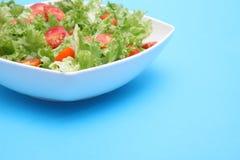 Fresh salad - lettuce and tomatoes. Fresh salad - green lettuce and red tomatoes Royalty Free Stock Image