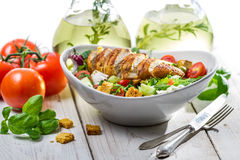 Fresh salad made of chicken, tomato, olive and fresh herbs Royalty Free Stock Images