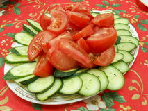 Fresh salad made of sliced cucumbers and tomatoes Royalty Free Stock Photos