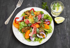 Fresh Salad Meal with Tomatoes,Lettuce,Peppers, Onion and Grille Stock Photography