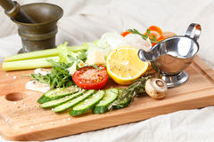 Fresh salad mix, sliced vegetables, olive oil and spices Stock Images