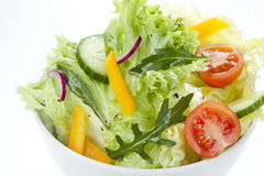Fresh salad mix in a white bowl from above Stock Photos