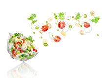 Fresh salad. Mixed falling vegetables Royalty Free Stock Images
