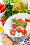 Fresh salad with mozzarella and cherry tomatoes, top view Stock Photography