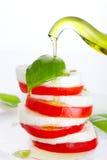 Fresh salad with mozzarella, tomato and basil stock images