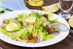 Fresh salad with mushrooms, squid and quail eggs Royalty Free Stock Photography